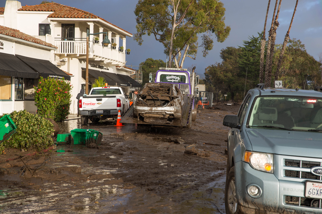 Mud and debris litter a Montecito roadway.