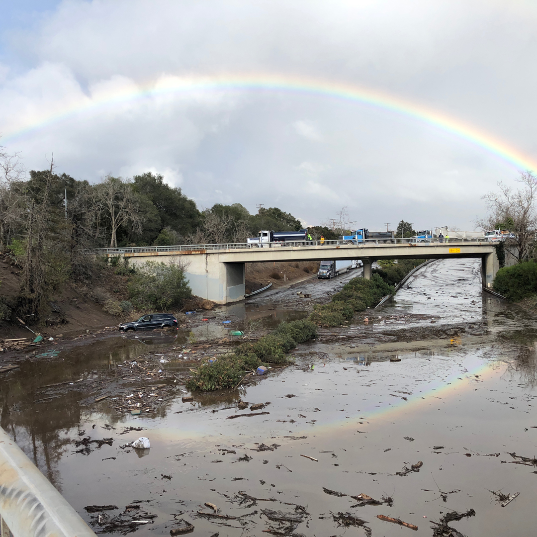 A rainbow forms above flooded Highway 101 on Jan. 9 in Montecito.
