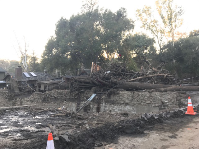 Trees and other debris piles up in Montecito.