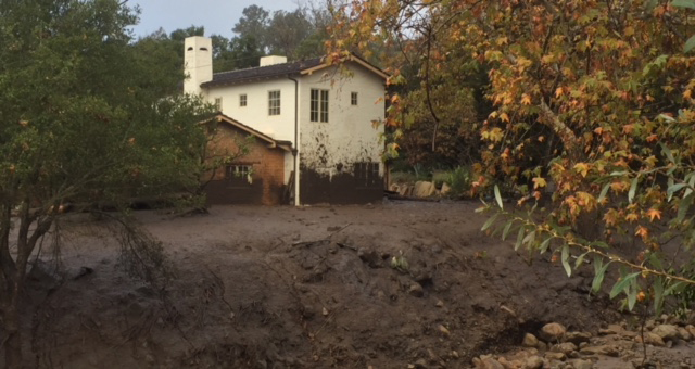 Mud smears a home in Toro Canyon.