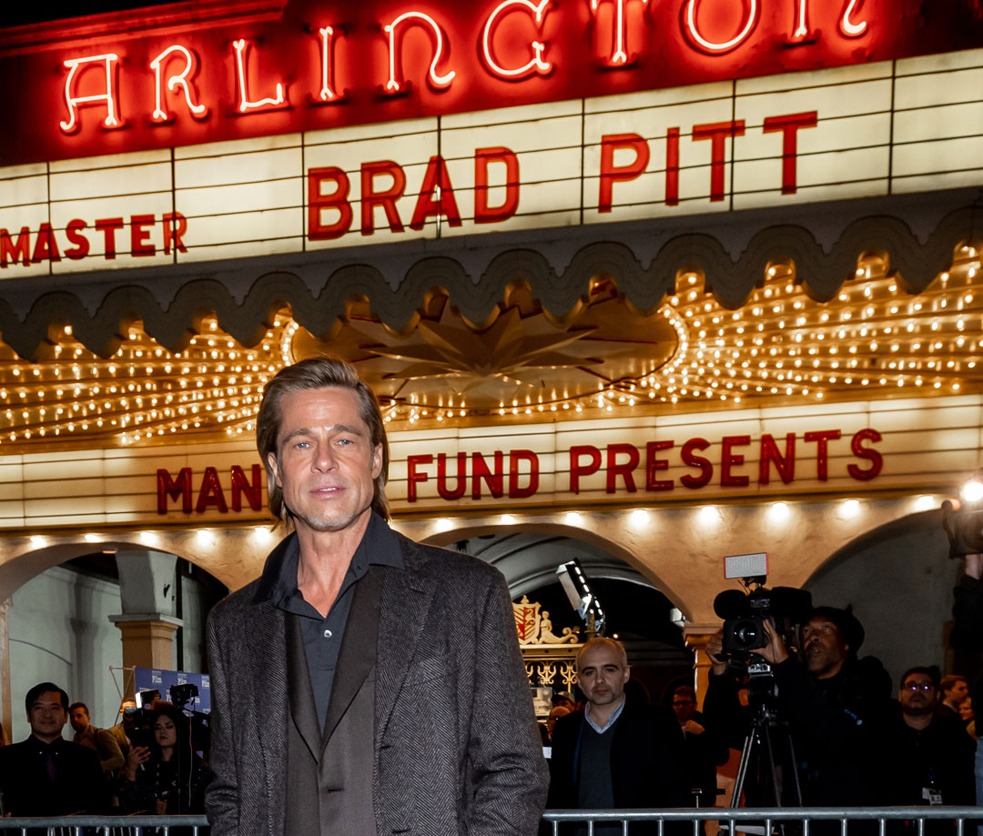 Actor Brad Pitt in front of the marquee at the Arlington Theater.