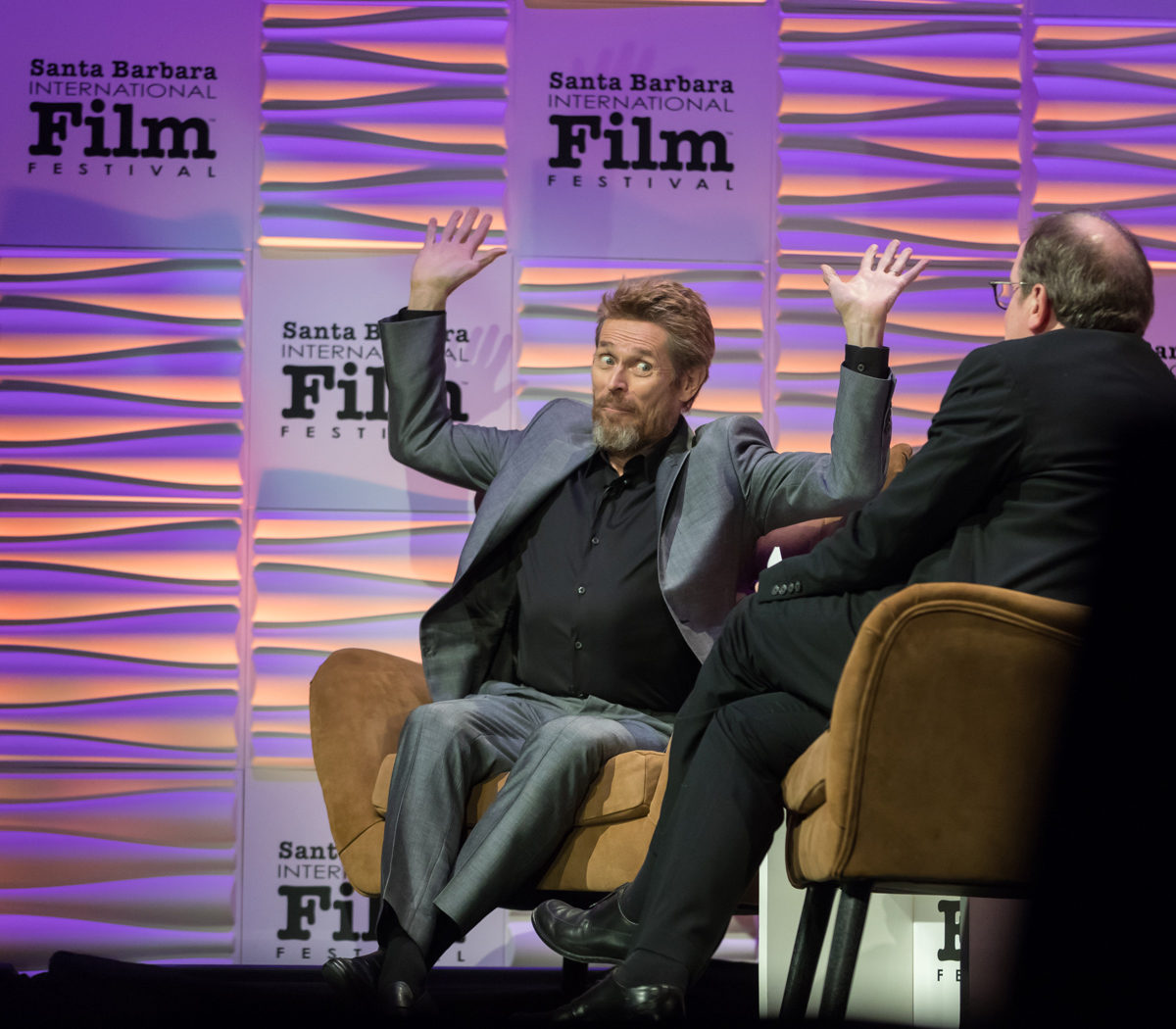 Willem Dafoe speaks with film critic Peter Hammond at the Arlington Theatre in Santa Barbara Thursday night.