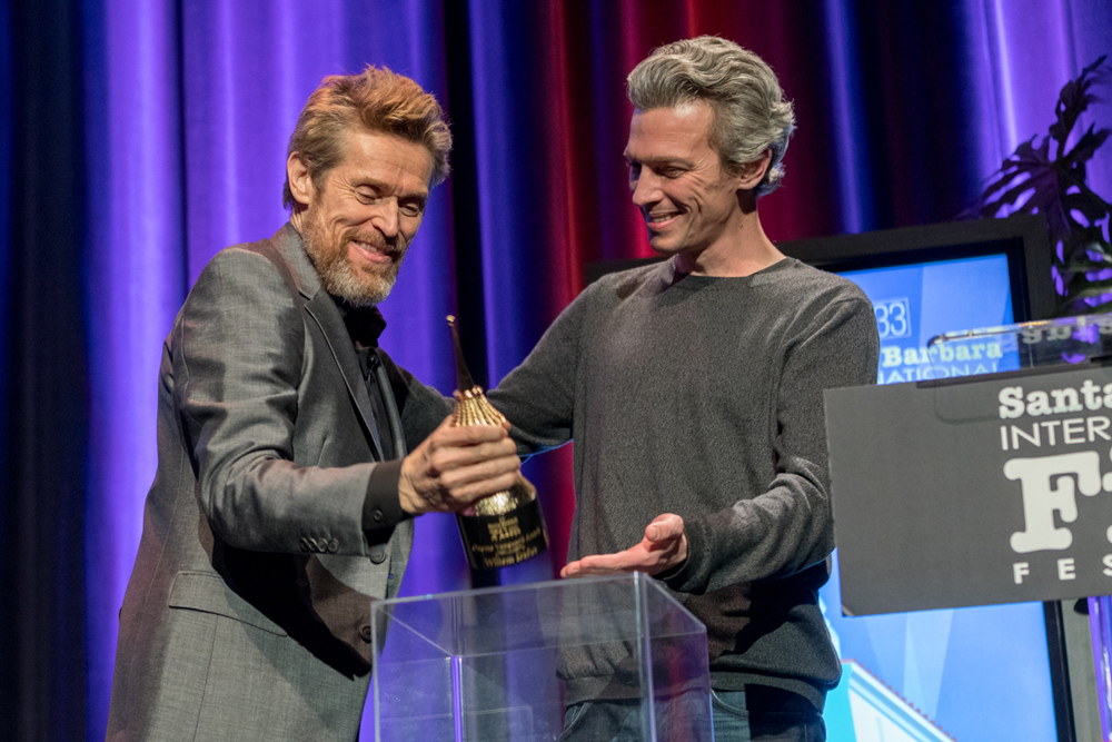 Director Josh Boone presents actor Willem Dafoe, left, with the Cinema Vanguard award at the Santa Barbara International Film Festival Thursday night.