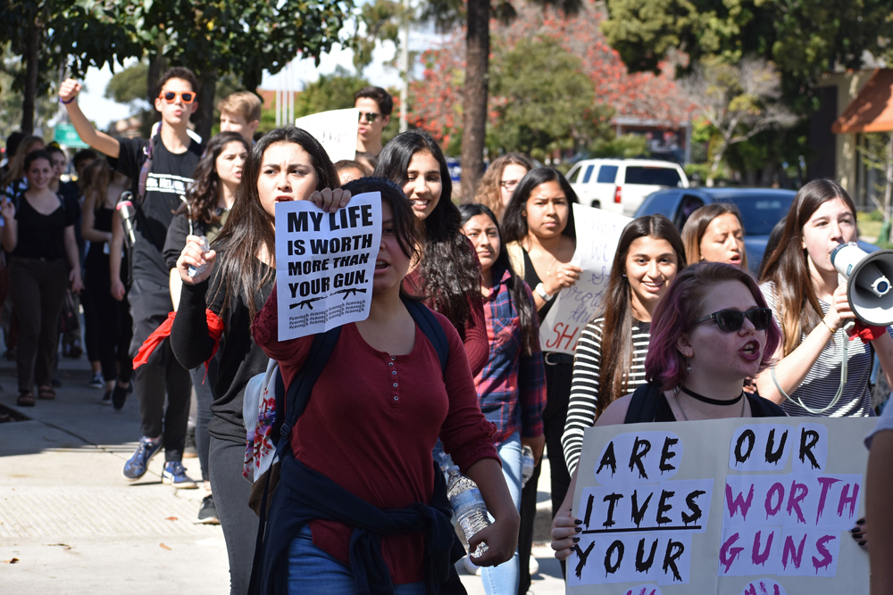 Hundreds of San Marcos High School students marched in the streets on Wednesday, ending at La Cumbre Plaza in Santa Barbara as part of a nationwide protest against gun violence.