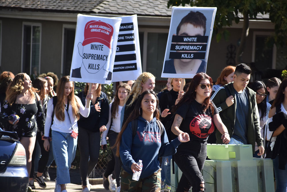 Santa Barbara High School students march to the County Courthouse Sunken Gardens Wednesday during the National School Walkout.