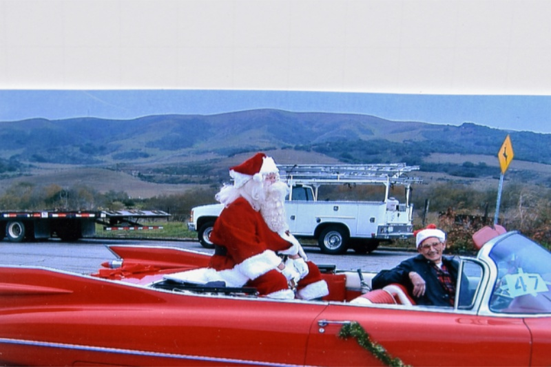 John Chuffield, Santa Claus and his beloved candy apple-red Cadillac convertible.