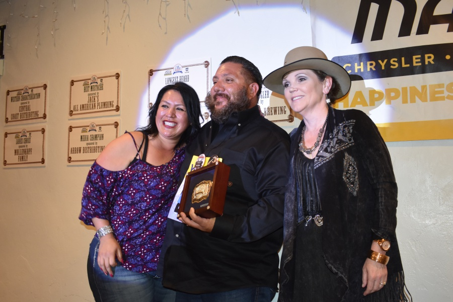 Santa Maria Elks Beard-A-Reno contestant Tommy Barrios captured the wildest whiskers category. Afterward, he got some time in the spotlight with his wife, Bernice, left, and Kristine Mollenkopf, who was hunting for candidates for the ladies' choice category.