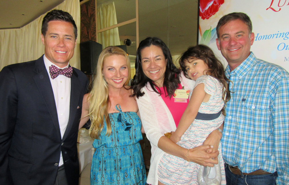 Emcee Andrew Firestone, left, and wife Ivana with Rochelle and Adam Karr and their daughter, Makenna.