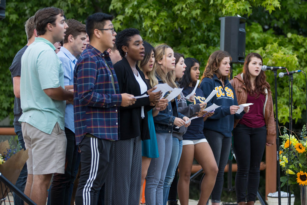 A group of singers performs Tuesday night in Isla Vista's Anisq'Oyo Park during a ceremony to commemorate the victims killed in the Isla Vista massacre three years ago.