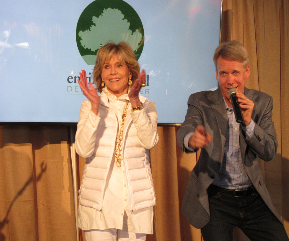 Honoree/actress Jane Fonda, with auctioneer Jim Nye, helps raise funds for the Environmental Defense Center during the Green & Blue fundraising event.
