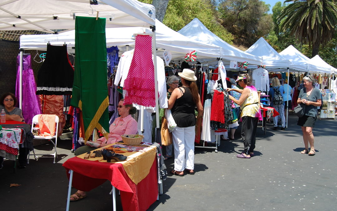 A crowd browses the Fiesta costume sale at the Santa Barbara's Carriage and Western Art Museum parking lot.