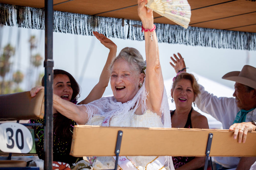 Lia Parker, first Spirit of Fiesta, waves to the crowd along the parade route.