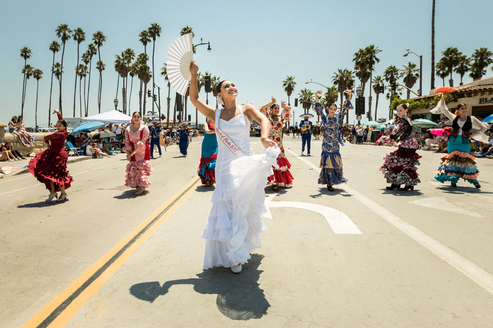Spirit of Fiesta Norma Escárcega dances her way down Cabrillo Boulevard Friday during the 93rd annual El Desfile Histórico, a highlight of the Old Spanish Days Fiesta in Santa Barbara.