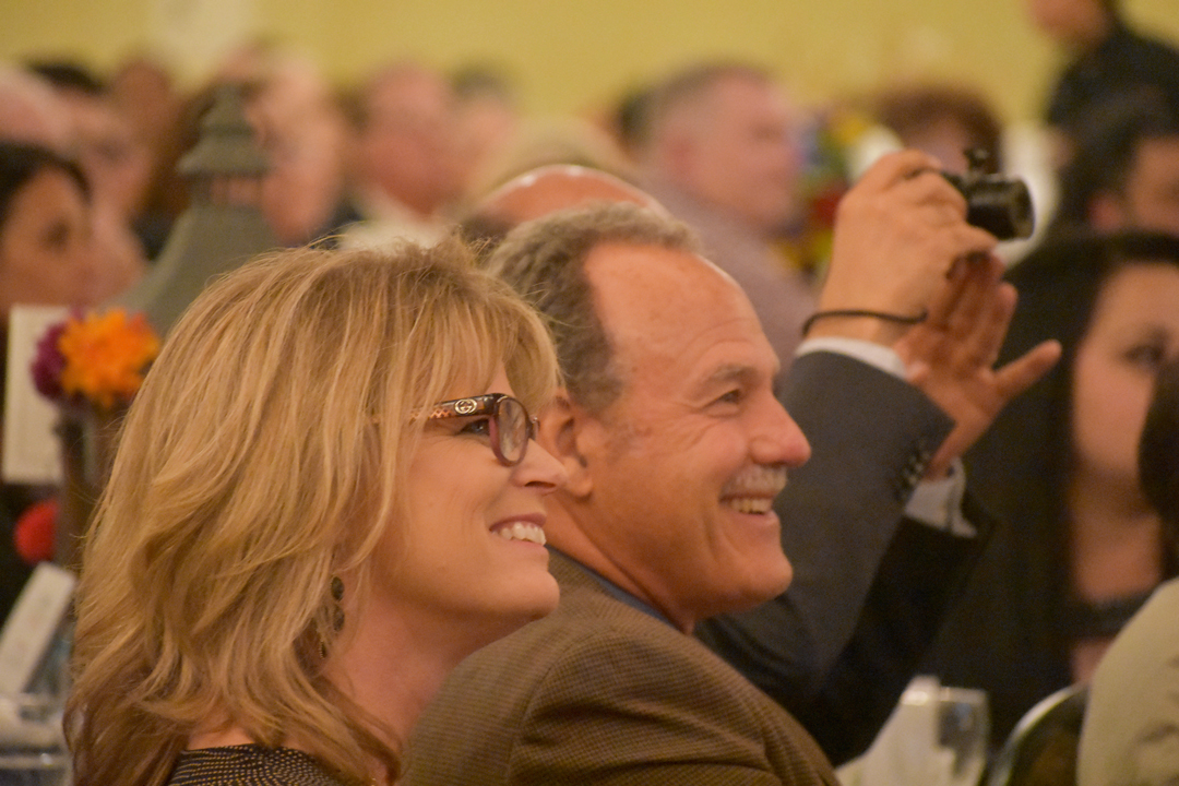 Donna and Greg France of Red Dog Management smile before receiving the Large Business of the Year Award during the Santa Maria Valley Chamber of Commerce annual awards dinner on Thursday night.