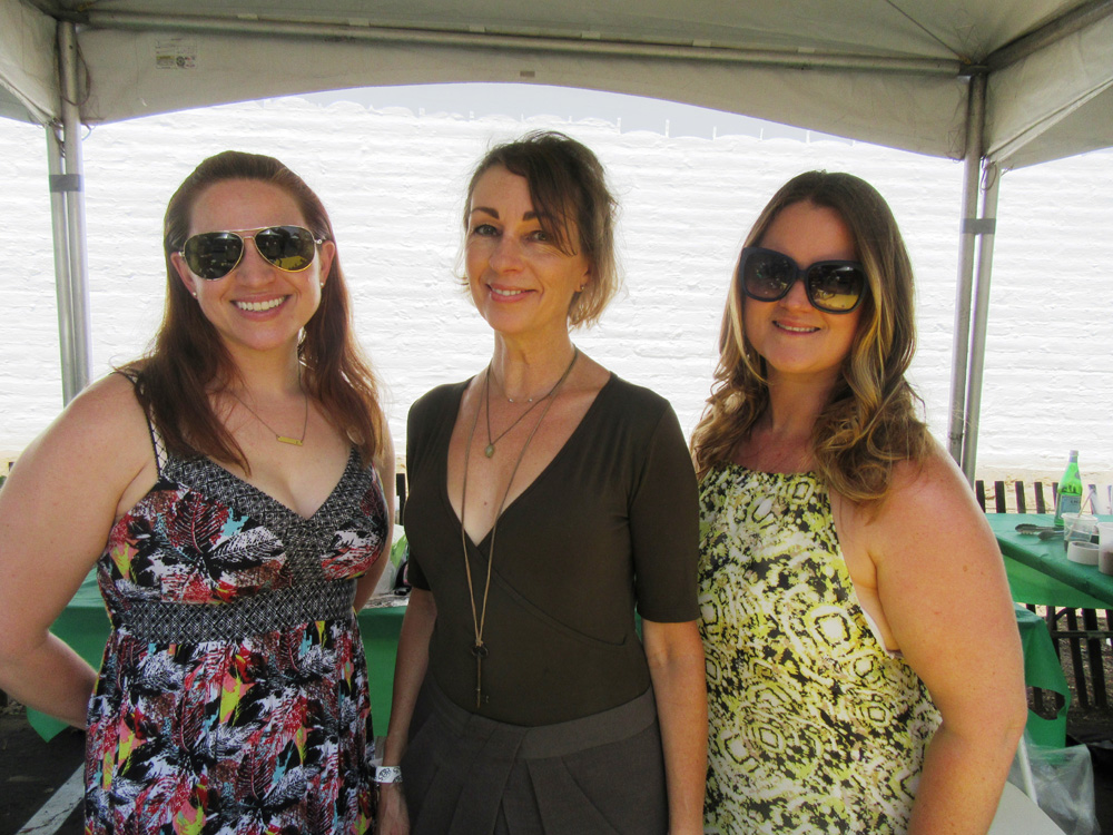 Rachel Johnson, left, Allison Kross and Lucille Boss represented winery purveyors at a booth.