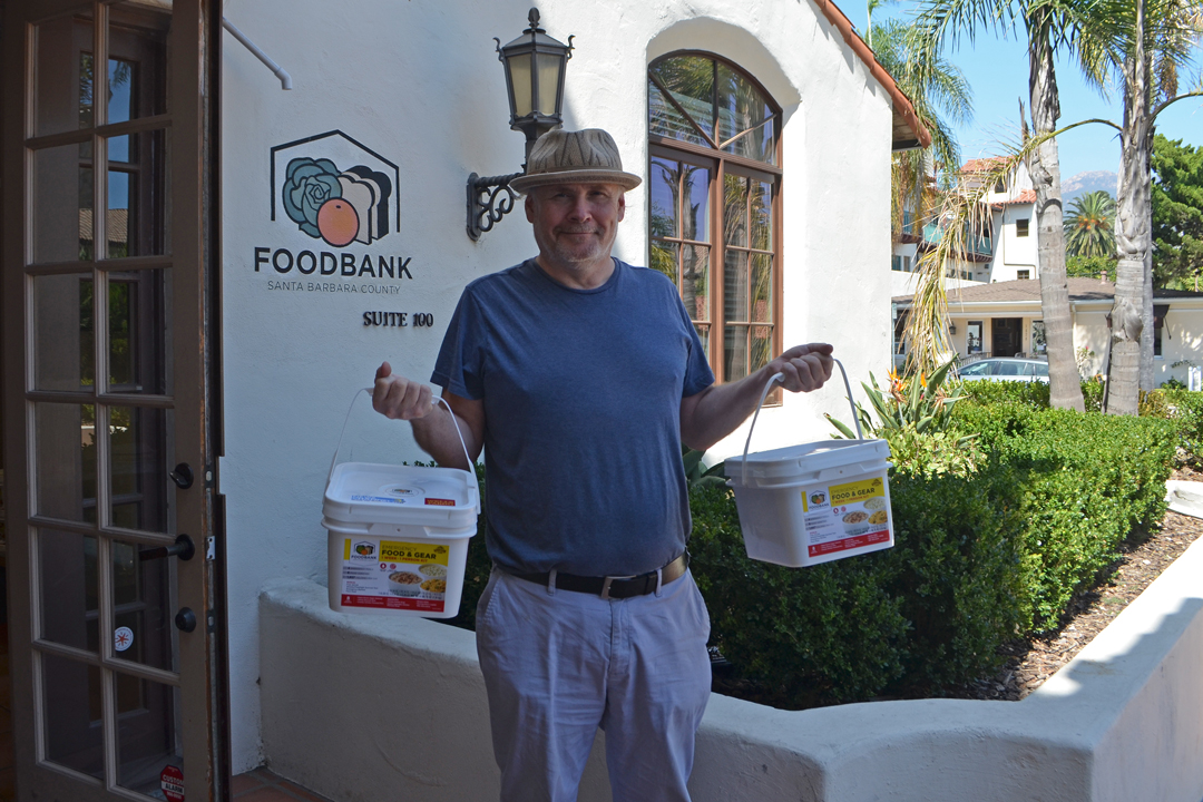 CEO Erik Talkin shows off the Foodbank of Santa Barbara County's emergency food boxes. For every box purchased, the nonprofit will donate one to a family in need.