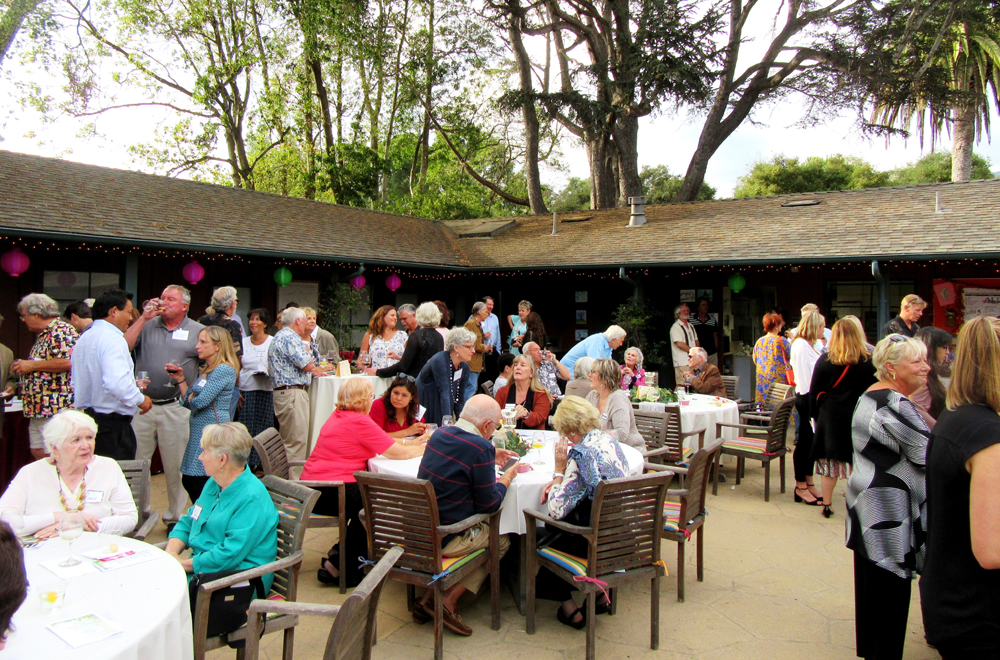 Supporters fill the courtyard for the Wine Down event.