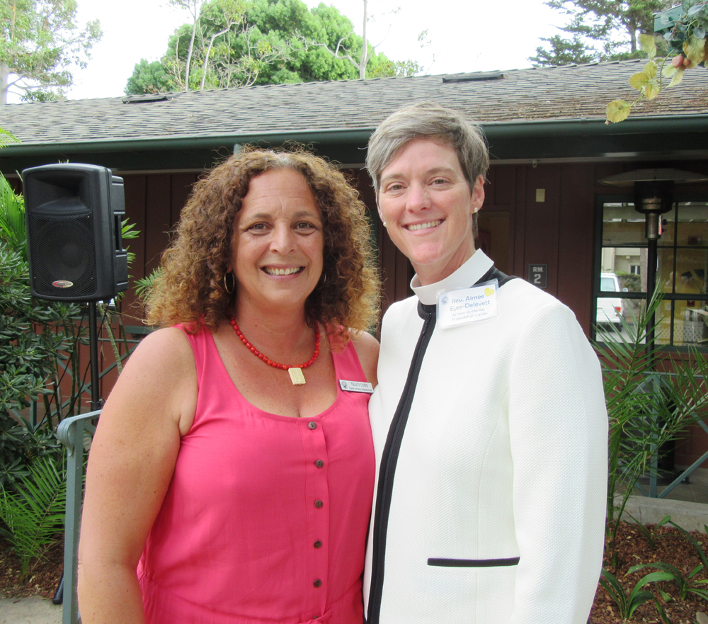 Friendship Center staff member Tracy Cohn, left, with the Rev. Aimee Eyer- Delevett of All Saints-by-the Sea Episcopal Church.
