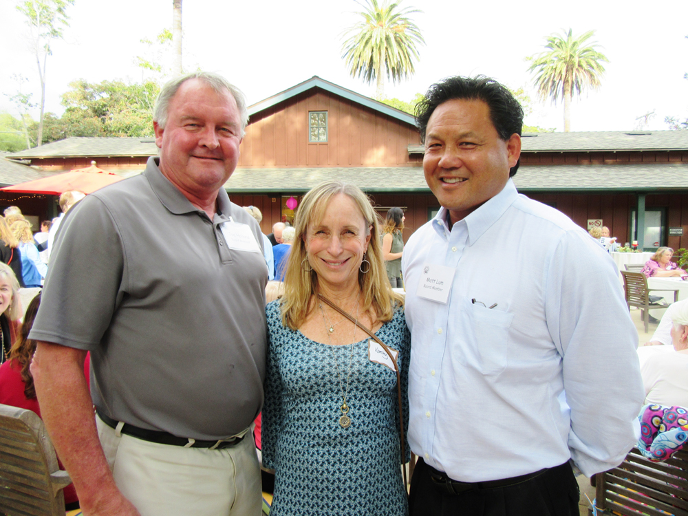 New board members Joe Holland, left, and Matt Lum with Kathy Holland.