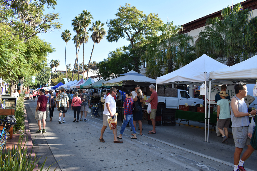 Locals buy fruits and vegetables during the weekly Santa Barbara Farmers Market, held every Tuesday on State Street between Haley and Ortega streets.