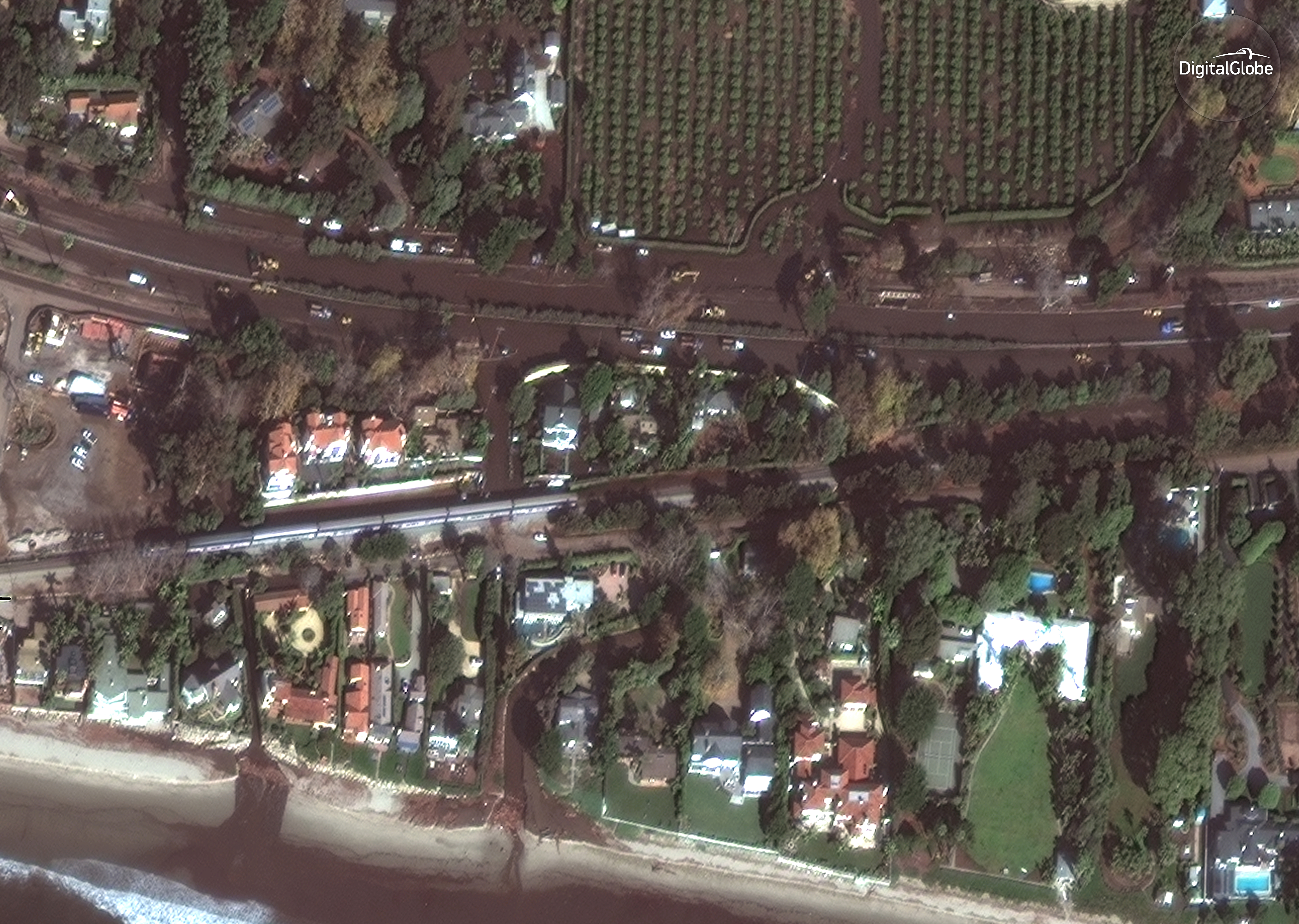 A GeoEye-1 satellite shows cleanup of Highway 101 after the mudslide in Montecito.