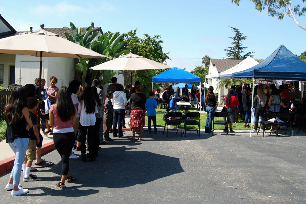 "Children in preschool through high school and their families lined up at Housing Authority of the City of Santa Barbara's Presidio Springs Community Center for the organization's fourth ""Tools for School"" event."