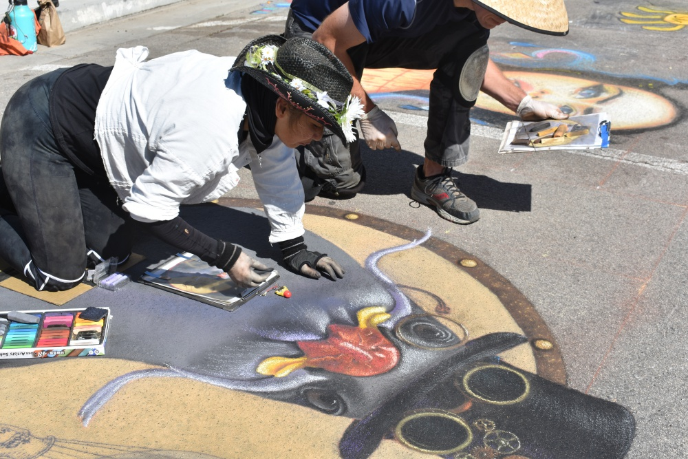 Sharyn Chan of Goleta works on her chalk art Saturday during the Orcutt Children's Arts Foundation Chalk Festival.