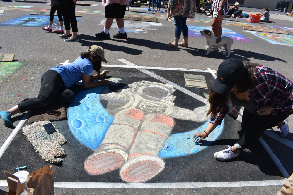 Sisters Monique and Dominique Padron put the finishing touches on their artwork during the Orcutt Children's Arts Foundation Chalk Festival.