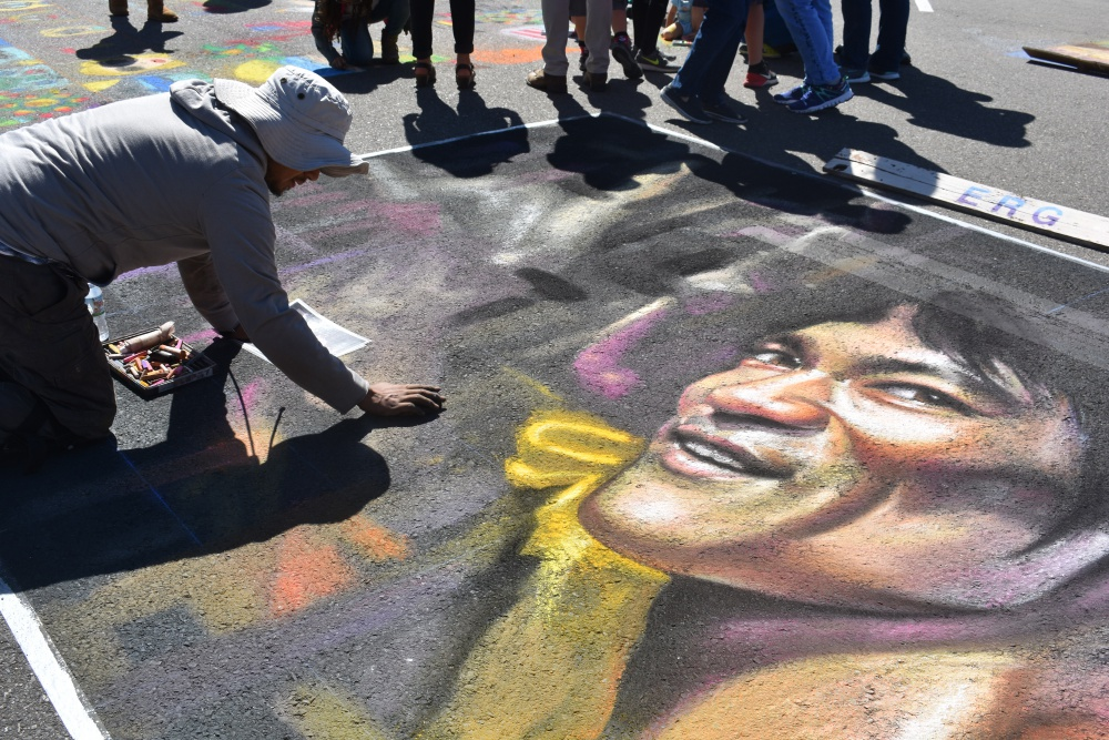Muralist Ever Galvez works on his highly detailed art at the heart of the Orcutt Children's Arts Foundation Chalk Festival on Saturday.