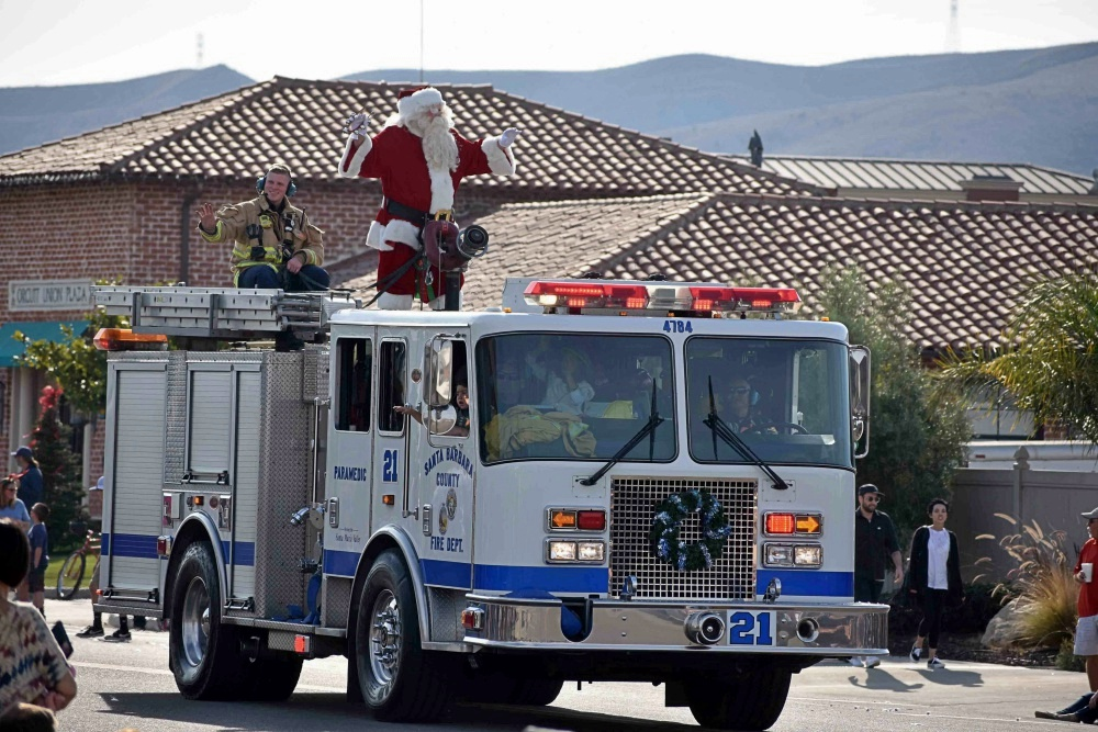 Santa Claus catches a ride Saturday on a Santa Barbara County fire engine from Station 21, a long-standing tradition of the Old Town Orcutt Christmas Parade.