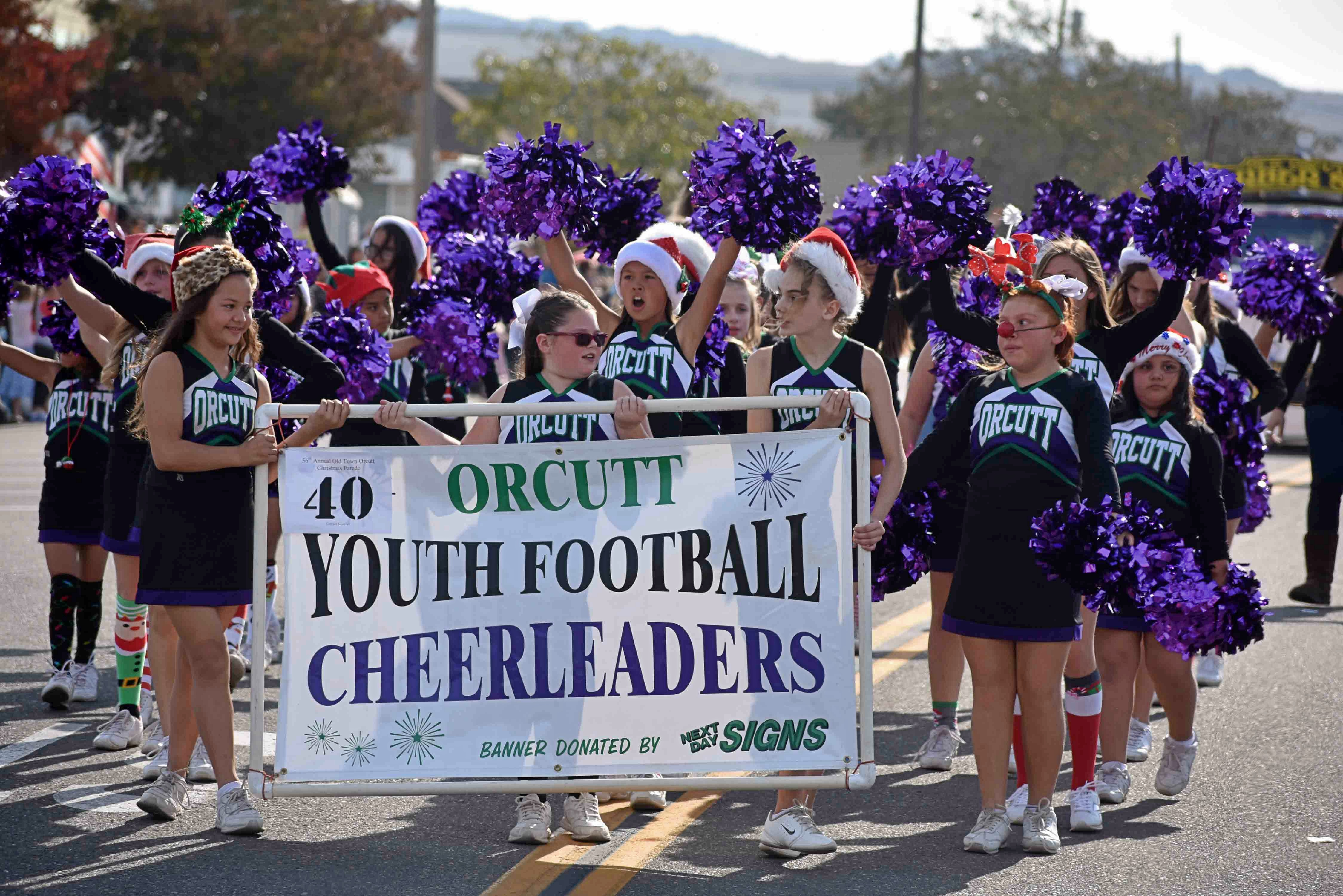 Orcutt Youth Football Cheerleaders display their spirit in the Old Orcutt Christmas Parade.