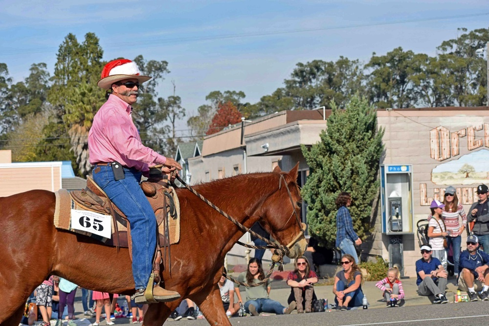 Santa Barbara County Fourth District Supervisor Peter Adam rides in Saturday's Old Orcutt Christmas Parade.