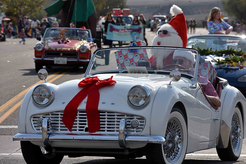 Paradise British Car Club members drive the Old Orcutt Christmas Parade route.