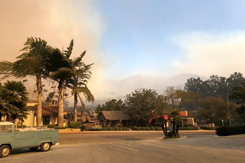 Early Saturday, the wildire burning above Montecito's Upper Village was growing in opposite directions.