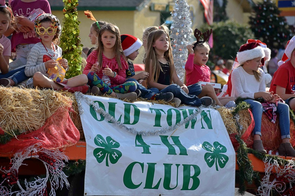 Old Town 4-H Club members fill a trailer for the Old Orcutt Christmas Parade on Saturday.