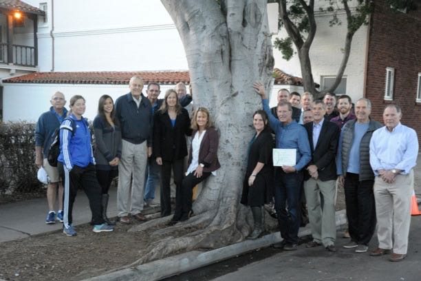 "Crandell family members and Santa Barbara Athletic Round Table board members gather around a tree that was dedicated to the memory of the late Larry Crandell, ""Mr. Santa Barbara,"" outside the Carrillo Street Gym in downtown Santa Barbara."