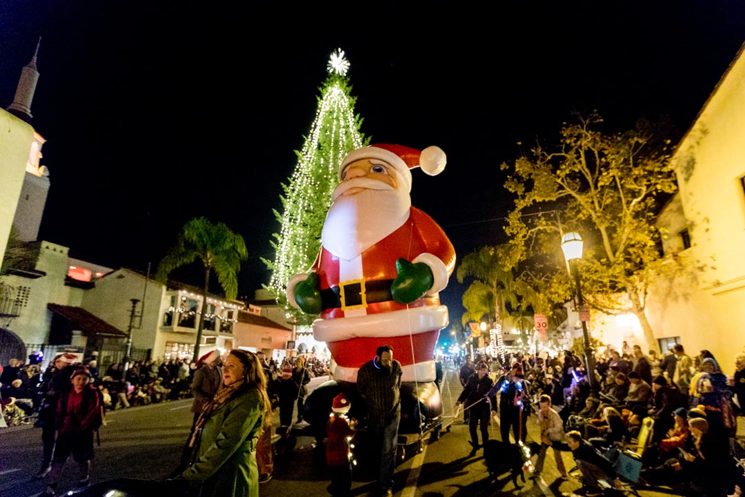 Thousands of people crowd State Street for Downtown Santa Barbara's annual nighttime Holiday Parade.