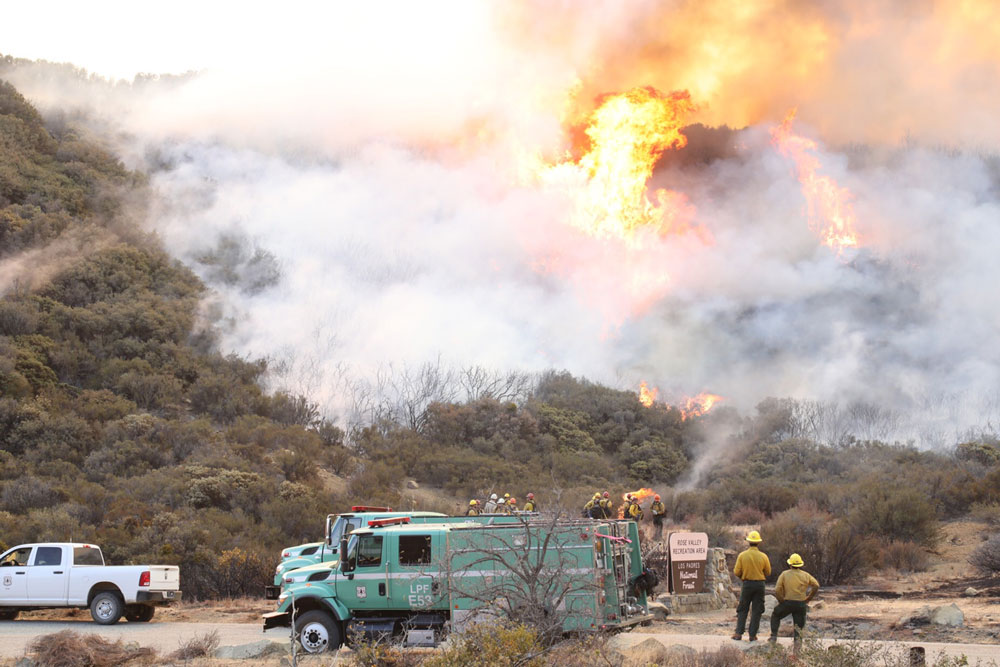 Firefighters conduct a 'burn-out' Saturday in the area of Highway 33 and Rose Valley north of Ojai, trying to block the past of the Thomas Fire farther into Los Padres National Forest.