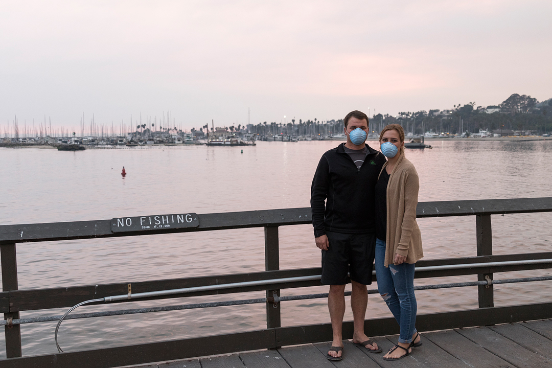 Visalia couple Jacob Tevelde and Lindsey Vizzllini wore masks while visiting the Santa Barbara Harbor and Stearns Wharf Wednesday.
