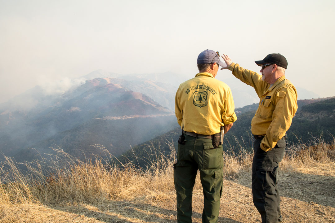Fire managers observe the Thomas Fire Wednesday afternoon along Camino Cielo above Santa Barbara.