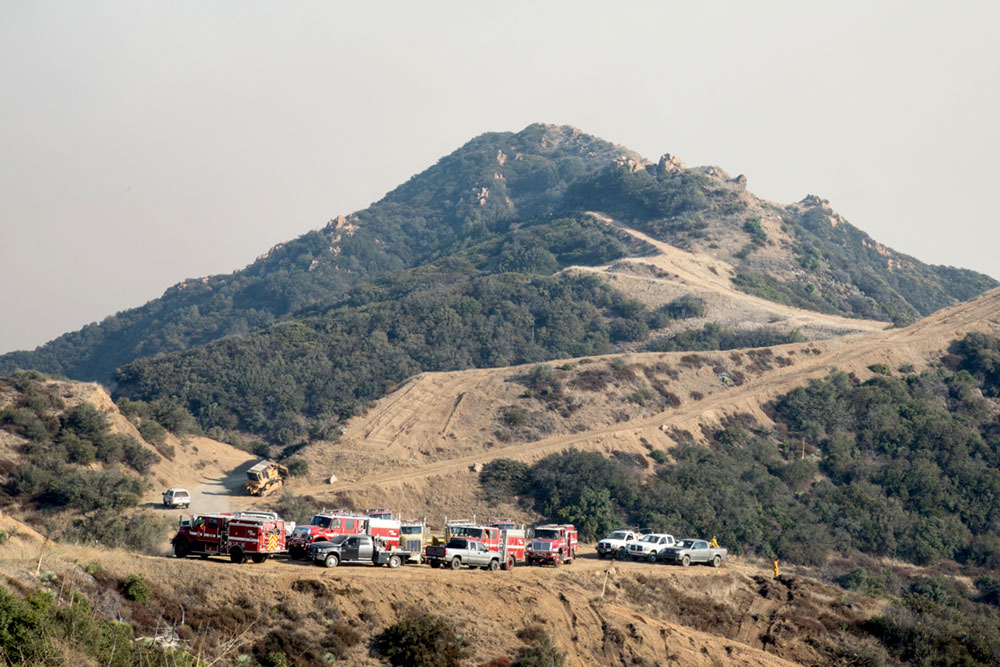 Crews spent much of the day Wednesday building and expanding containment lines along the ridge of the Santa Ynez Mountain to use in case direct attack on the flames of the Thomas Fire does not halt its progress.