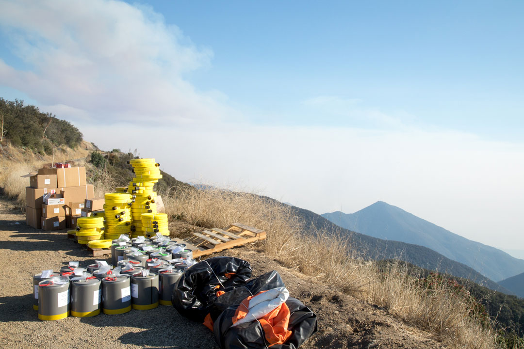 Hoses and other firefighting supplies are positioned along Camino Cielo in the mountains above Santa Barbara.
