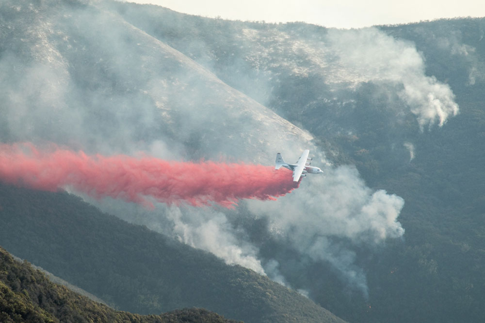 An air tanker drops retardant west of Romero Canyon in southern Santa Barbara County Wednesday afternoon.