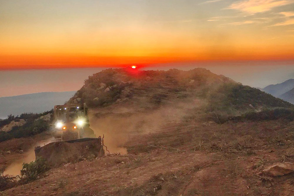 Five engines and two bulldozers from the Santa Barbara County Fire Department were clearing a fire break and laying 10,000 feet of hose across a canyon from atop Camino Cielo down to Gibraltar Road to make a stand should the fire move that direction.