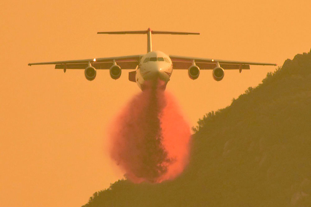 A BAe-146 air tanker drops a load of fire retardant along East Camino Cielo on Thursday as firefighters continue their efforts to stop the spread of the Thomas Fire in Santa Barbara County.