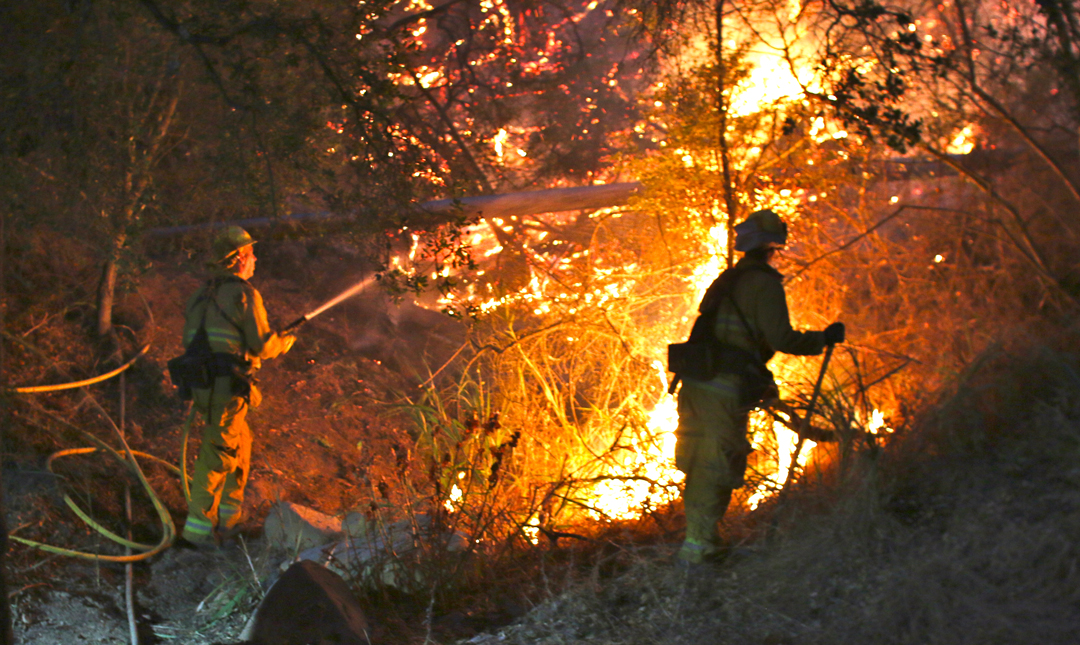 A firefighter stands watch during a Toro Canyon backburning operation Tuesday.