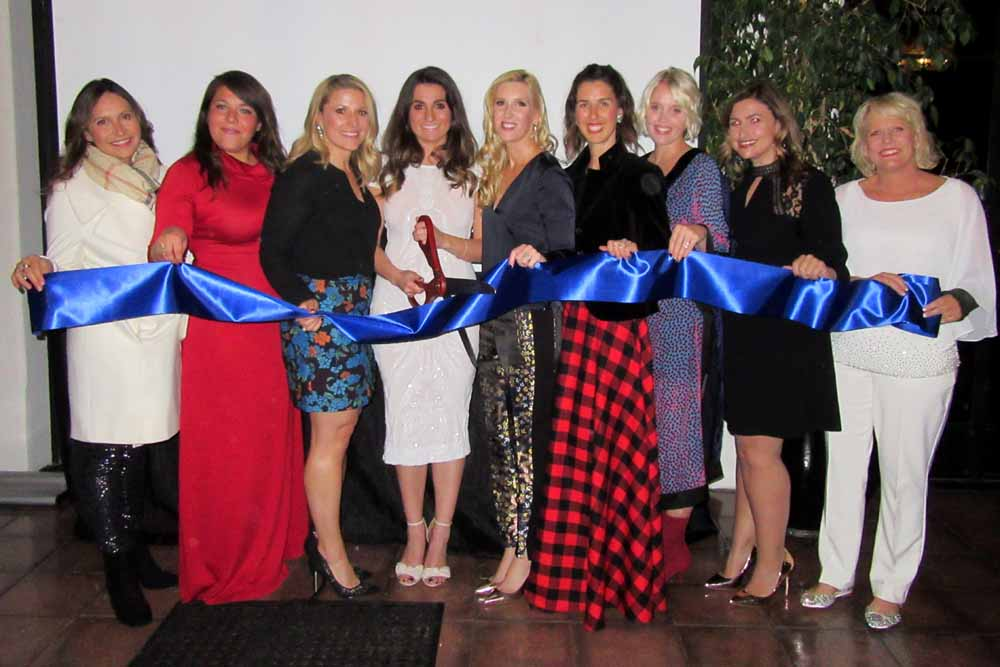 The Junior League of Santa Barbara's ceremonial ribbon-cutting for its S.A.F.E. House included board members, from left, Sarah Main, Jenni-Elise Ramirez, Lindsay Cortina, Danielle Hazarian, Kielle Horton, Kate Perlis McKinniss and Anne-Marie Cabot, and Marissa Bryne, an active adviser to the board, and Kris Hart, executive director of 4 Kids 2 Kids.