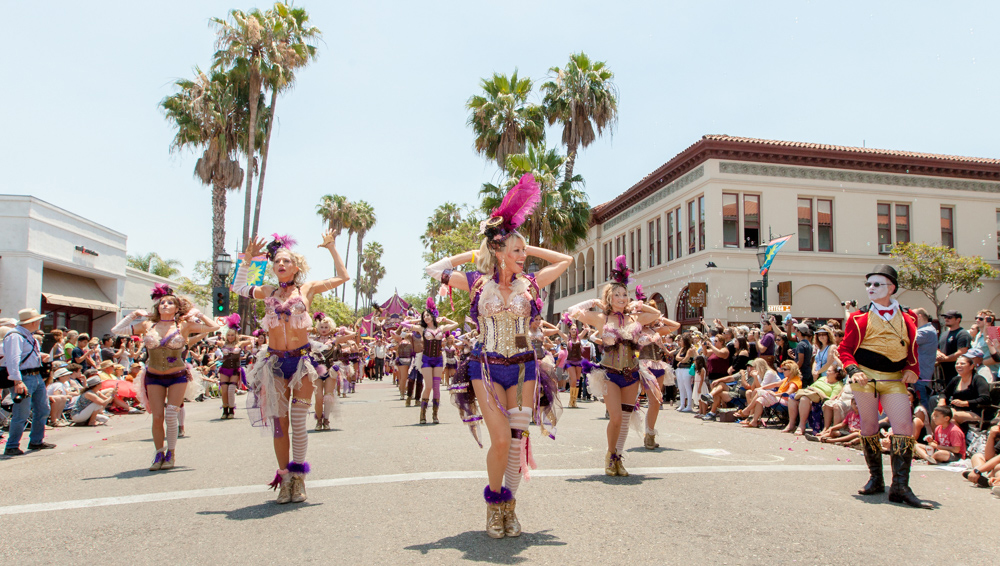 Colorful dancers make their way up State Street during Santa Barbara's Solstice Parade.