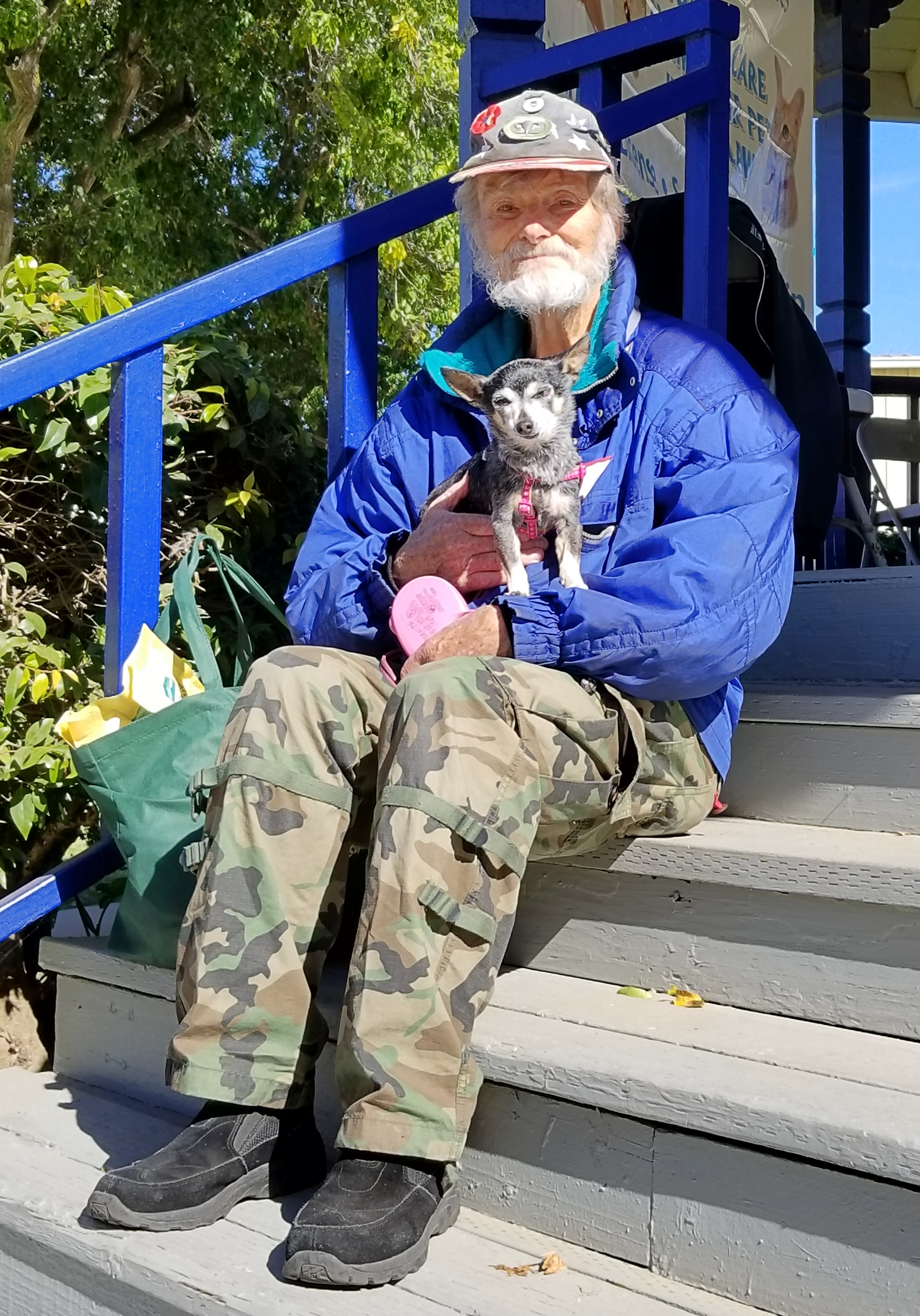 Lompoc resident and Vietnam War veteran Ron Herbib sits in the sun with his 12-year Chihuahua, Juanita Chiquita Margarita, after the pooch received a free grooming during Saturday's Santa Barbara County Stand Down.