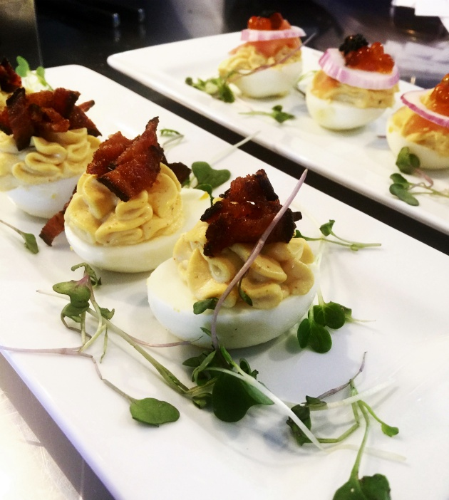 Perfect, creamy deviled eggs are topped with candied bacon and fried onion.